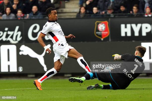Benoit Costil of Rennes and Alassane Plea of Nice during the Ligue 1 match between Stade Rennais and OGC Nice at Roazhon Park on February 12 2017 in...