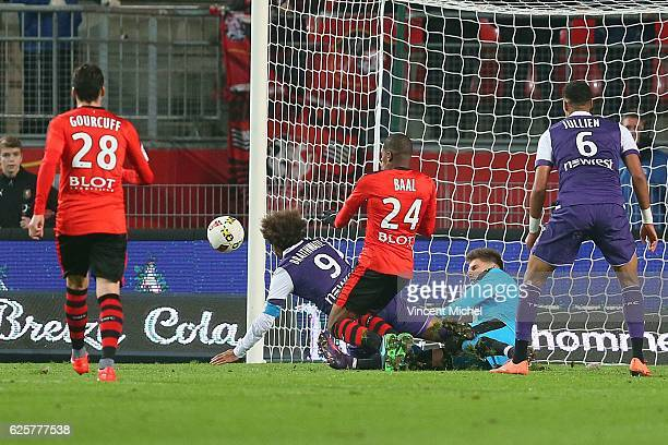 Benoit Costil of Rennes and Martin Braithwaite of Toulouse during the French Ligue 1 match between Rennes and Toulouse at Roazhon Park on November 25...
