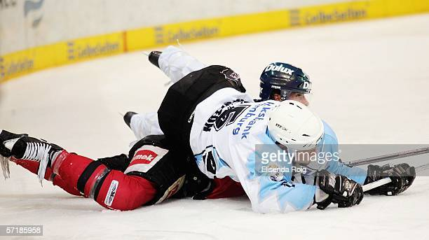Benoit Graton of the Freezers sits on Chris Ferraro of the Metros during the DEL Play Off quarter final sixth match between Hamburg Freezers and DEG...