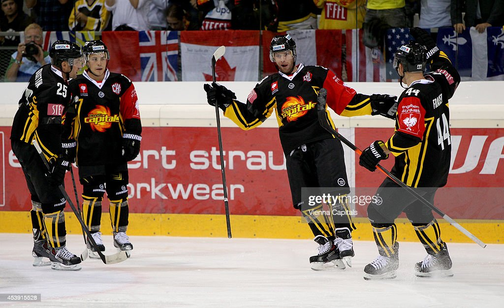 Benoit Gratton, Dustin Sylvester, Markus Schlacher and Jamie Fraser of the Capitals celebrate during the Champions Hockey League group stage game between Vienna Capitals and Faerjestad Karlstad on August 21, 2014 in Vienna, Austria.