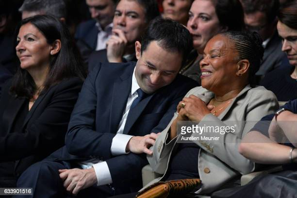 Benoit Hamon and Former French Minister of Justice Christiane Taubira react as members of the Socialist Party speak during his convention to become...