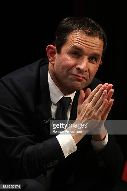 Benoit Hamon former French Education Minister and candidate in the left wing primaries ahead of France's 2017 presidential election looks on before...
