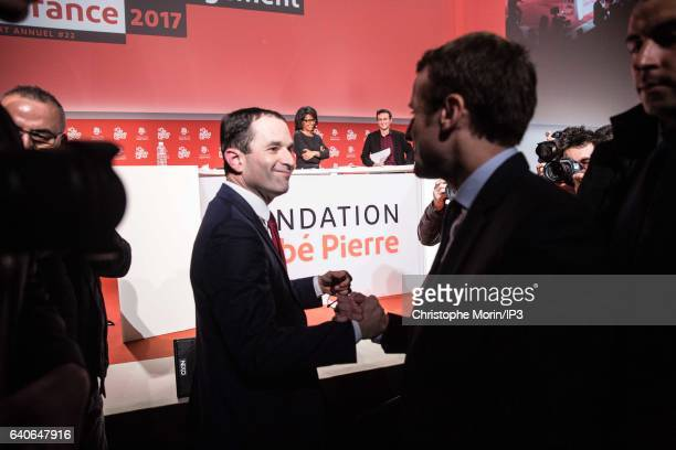 Benoit Hamon from Socialist Party greets Emmanuel Macron from the political movement 'En Marche ' both candidates for the 217 French Presidential...