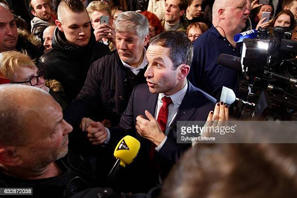 Benoit Hamon meets with supporters after his speech two days before leftwing primary's second round ahead of the French 2017 presidential election on...