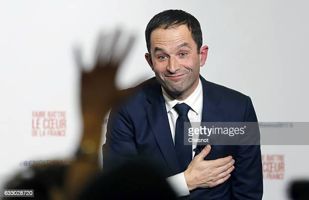 Benoit Hamon winner of the leftwing primaries ahead of France's 2017 presidential elections gestures after delivering a speech following the results...