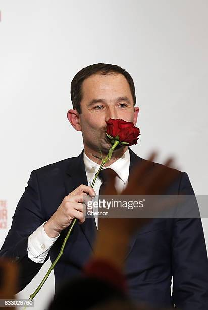 Benoit Hamon winner of the leftwing primaries ahead of France's 2017 presidential elections holds a rose after delivering a speech following the...