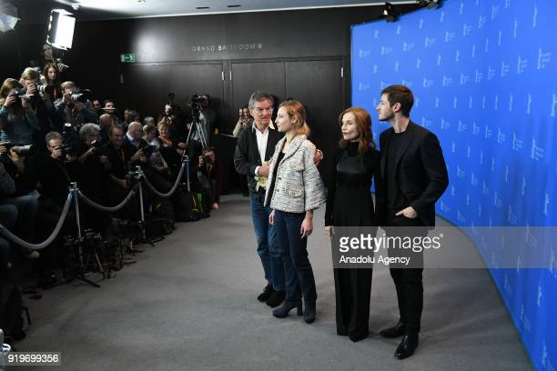 Benoit Jacquot Julia Roy Isabelle Huppert and Gaspard Ulliel pose for a photo at a photocall on the film 'Eva' during the 68th Berlinale...