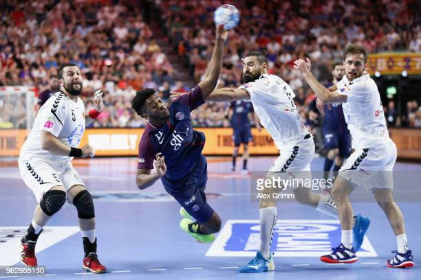 Benoit Kounkoud of Paris is challenged by Stojanche Stoilov Jorge Maqueda Pena and Luka Cindric of Vardar during the EHF Champions League Final 4...