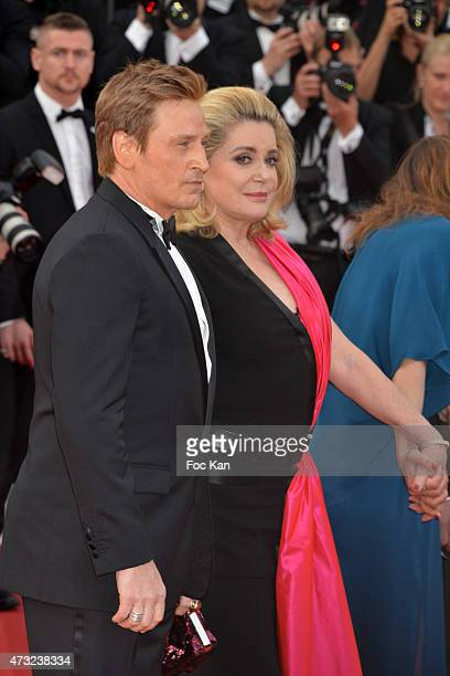 Benoit Magimel and Catherine Deneuve attend the opening ceremony and premiere of 'La Tete Haute during the 68th annual Cannes Film Festival on May 13...