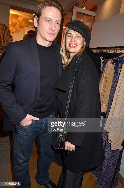 Benoit Magimel and Nikita aka Nathalie Lespinasse attend the Gerard Darel Flagship Opening With Robin Wright on March 9 2011 in Paris, France.