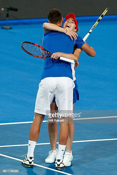Benoit Paire and Alize Cornet of France embrace after defeating Casey Dellacqua and Marinko Matosevic of Australia in the mixed doubles match during...