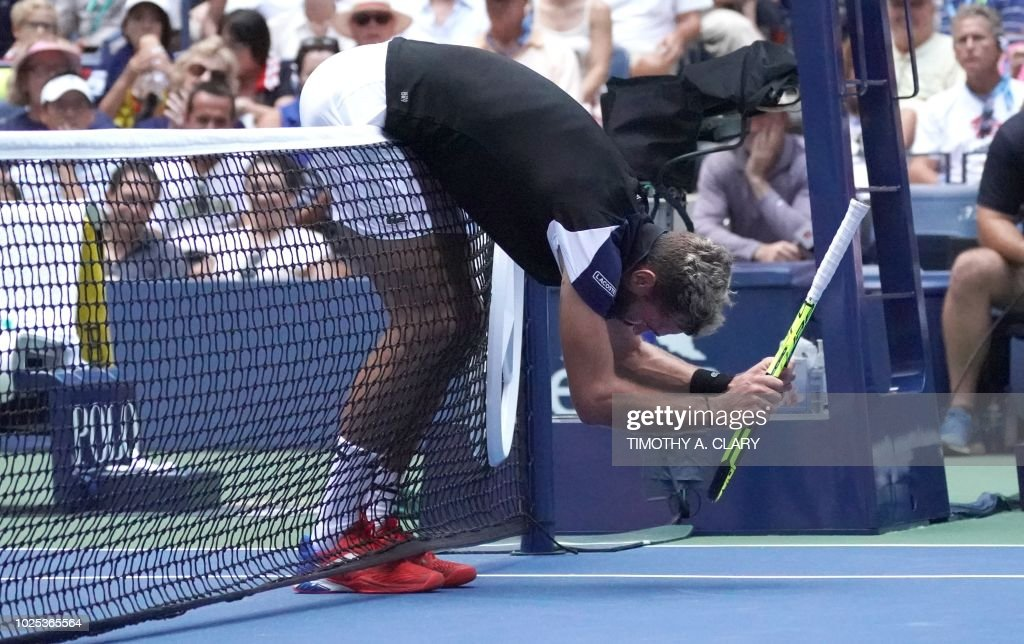 Benoit Paire of France against Roger Federer of Switzerland during Day 4 of the 2018 US Open Men's Singles match at the USTA Billie Jean King National Tennis Center in New York on August 30, 2018.
