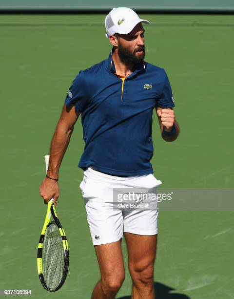 Benoit Paire of France celebrates a point against Novak Djokovic of Serbia in their second round match during the Miami Open Presented by Itau at...