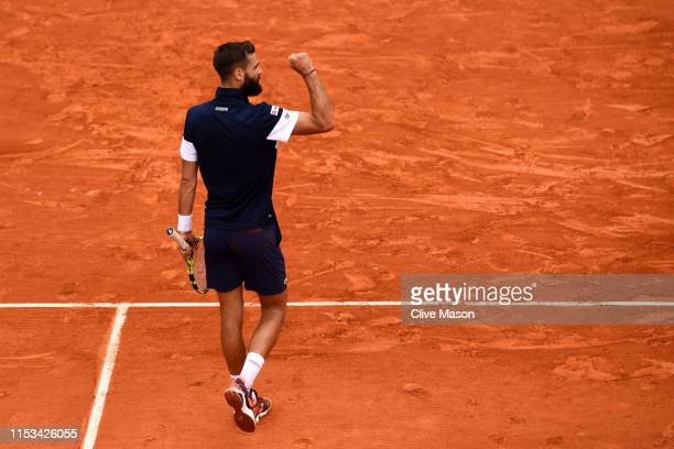 Benoit Paire of France celebrates during his mens singles fourth round match against Kei Nishikori of Japan during Day nine of the 2019 French Open...