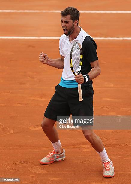 Benoit Paire of France celebrates match point against Juan Martin Del Potro of Argentina in their third round match during day five of the...