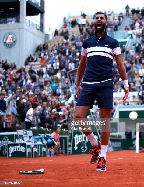 Benoit Paire of France celebrates victory during his mens singles second round match against PierreHugues Herbert of France during Day four of the...