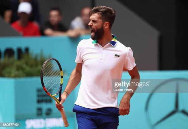 Benoit Paire of France celebrates winning a game in his match against Pablo Crreno Busta of Spain during day four of the Mutua Madrid Open tennis at...