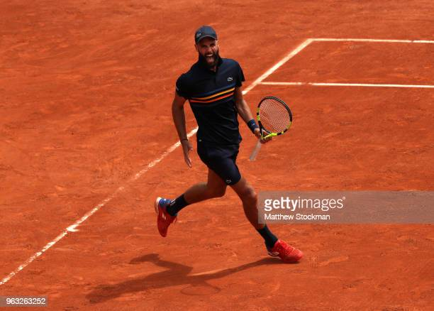 Benoit Paire of France celebrates winning a set during the mens singles first round match against Roberto Carballes Baena of Spain during day two of...