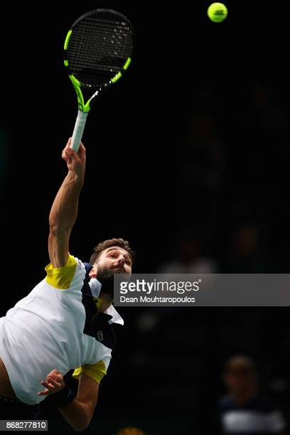 Benoit Paire of France competes against Richard Gasquet of France during Day 1 of the Rolex Paris Masters held at the AccorHotels Arena on October 30...