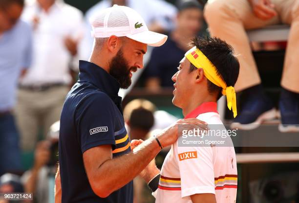 Benoit Paire of France congratulates Kei Nishikori of Japan on victory following their mens singles second round match during day four of the 2018...