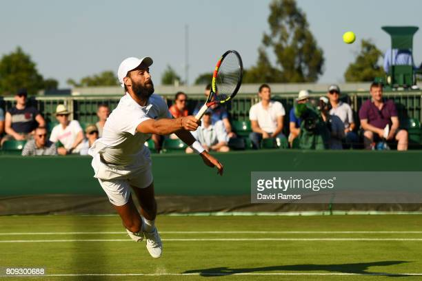 Benoit Paire of France dives to play a forehand during the Gentlemen's Singles second round match against PierreHugues Herbert of France on day three...