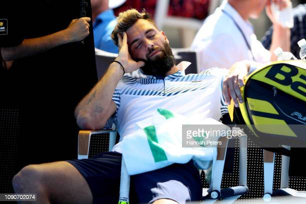 Benoit Paire of France falls asleep during the first round match against Cameron Norrie of Great Britain during the ASB Classic at the ASB Tennis...