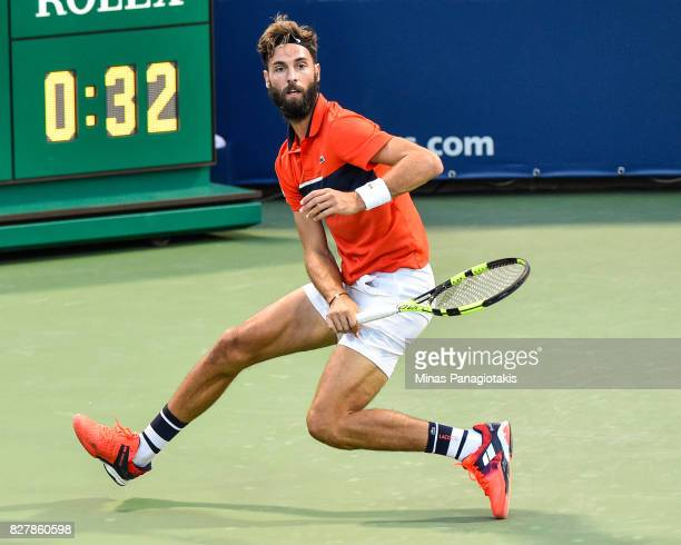 Benoit Paire of France hits a return shot against Jared Donaldson of the United States during day five of the Rogers Cup presented by National Bank...