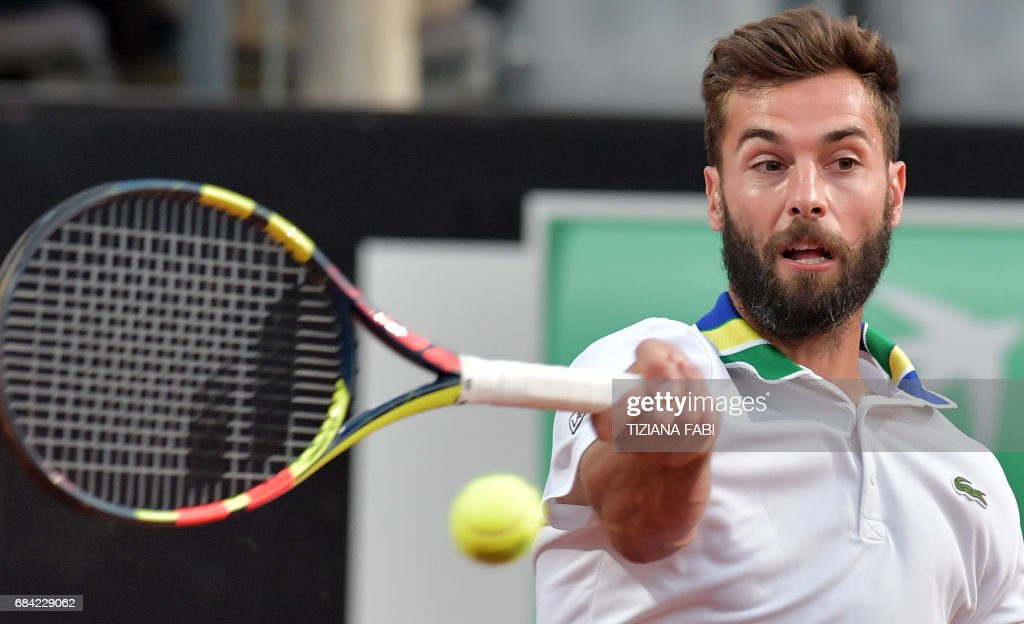 Benoit Paire of France hits a return to Stanislas Wawrinka of Switzerland during their match at the ATP Tennis Open tournament on May 17, 2017 at the Foro Italico in Rome. /
