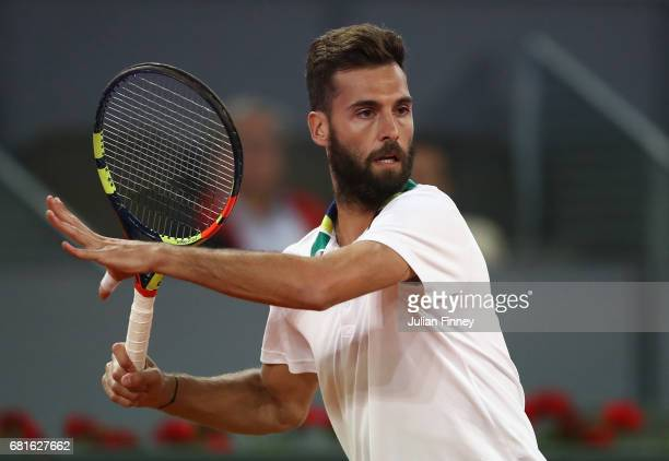 Benoit Paire of France in action against Stanislas Wawrinka of Switzerland during day five of the Mutua Madrid Open tennis at La Caja Magica on May...