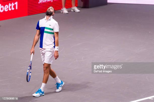 Benoit Paire of France looks dejected during day three of the Bett1Hulks Indoor tennis tournament between Benoit Paire and Dennis Novak at Lanxess...