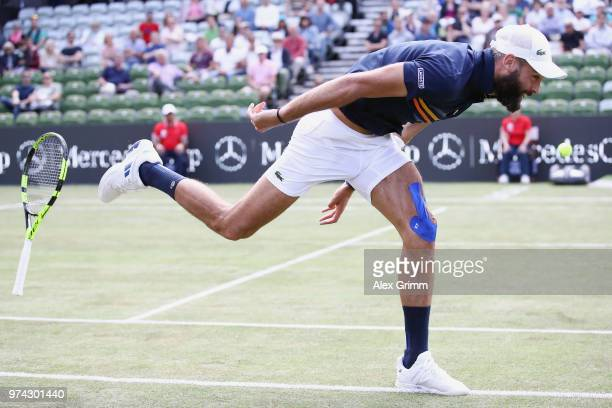 Benoit Paire of France loses his racket as he struggles during his match against Tomas Berdych of Czech Republic during day 4 of the Mercedes Cup at...