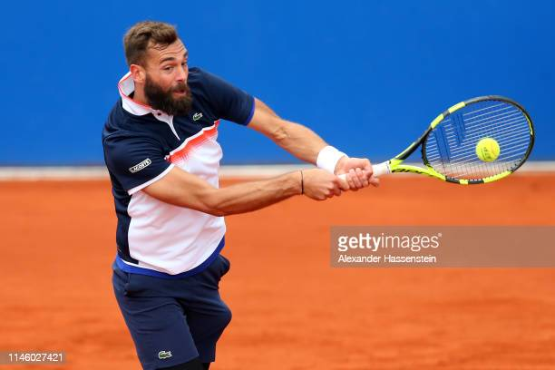 Benoit Paire of France plays a back during his first round match against Diego Schwartzmann of Argentina on day 4 of the BMW Open at MTTC IPHITOS on...