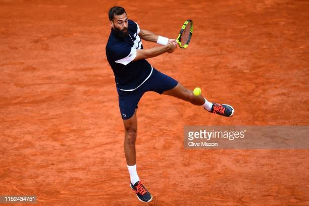Benoit Paire of France plays a backhand during his mens singles second round match against PierreHugues Herbert of France during Day four of the 2019...