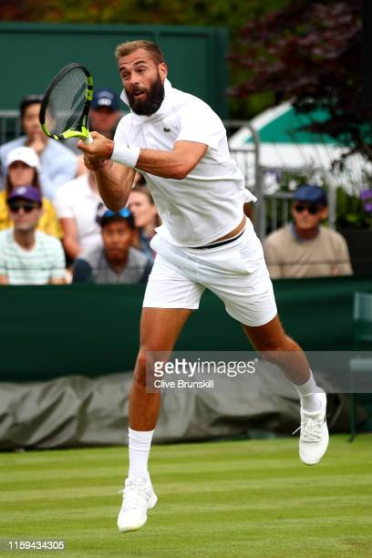 Benoit Paire of France plays a backhand in his Men's Singles first round match against Juan Ignacio Londero of Argentina during Day one of The...