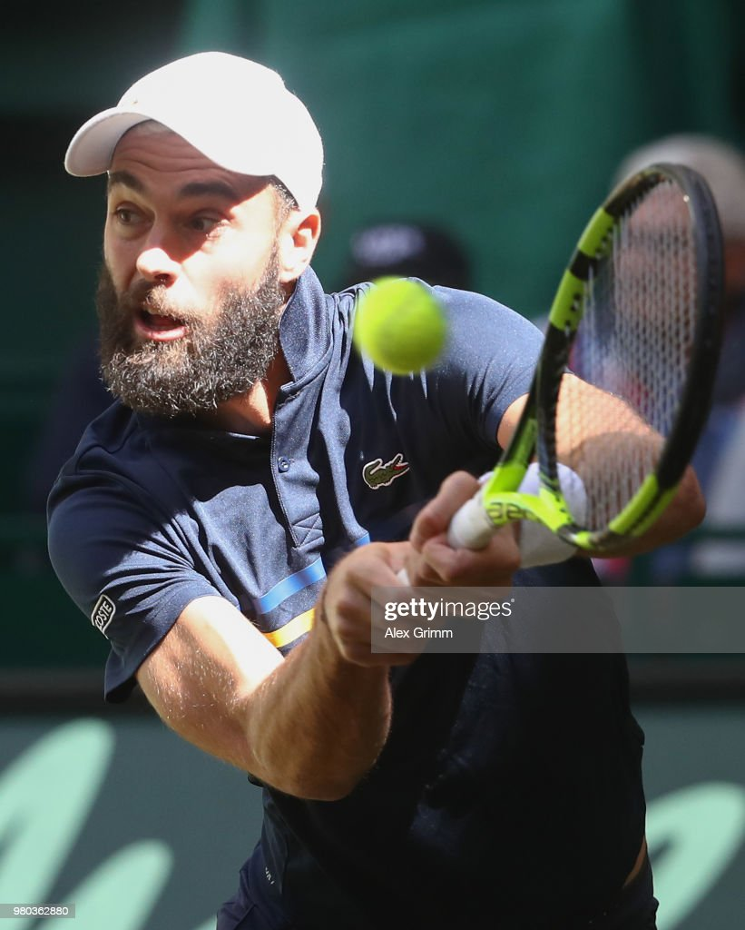 Benoit Paire of France plays a backhand volley to Roger Federer of Switzerland during their round of 16 match on day 4 of the Gerry Weber Open at Gerry Weber Stadium on June 21, 2018 in Halle, Germany.