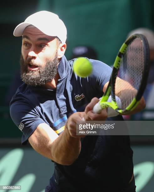 Benoit Paire of France plays a backhand volley to Roger Federer of Switzerland during their round of 16 match on day 4 of the Gerry Weber Open at...