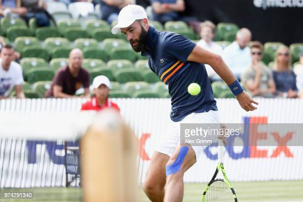 Benoit Paire of France plays a behind the back halfvolley during his match against Tomas Berdych of Czech Republic during day 4 of the Mercedes Cup...