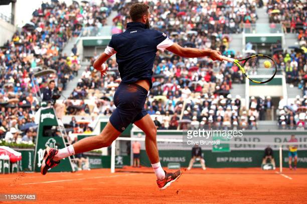 Benoit Paire of France plays a forehand during his mens singles fourth round match against Kei Nishikori of Japan during Day nine of the 2019 French...