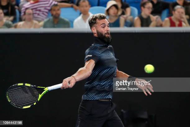 Benoit Paire of France plays a forehand in his match against Dominic Thiem of Austria during day two of the 2019 Australian Open at Melbourne Park on...