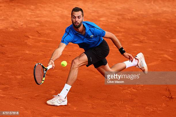 Benoit Paire of France plays a forehand in his Men's Singles match against Tomas Berdych of Czech Republic on day six of the 2015 French Open at...