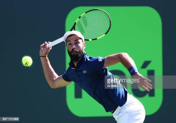 Benoit Paire of France plays a shot against Novak Djokovic of Serbia during Day 5 of the Miami Open at the Crandon Park Tennis Center on March 23...