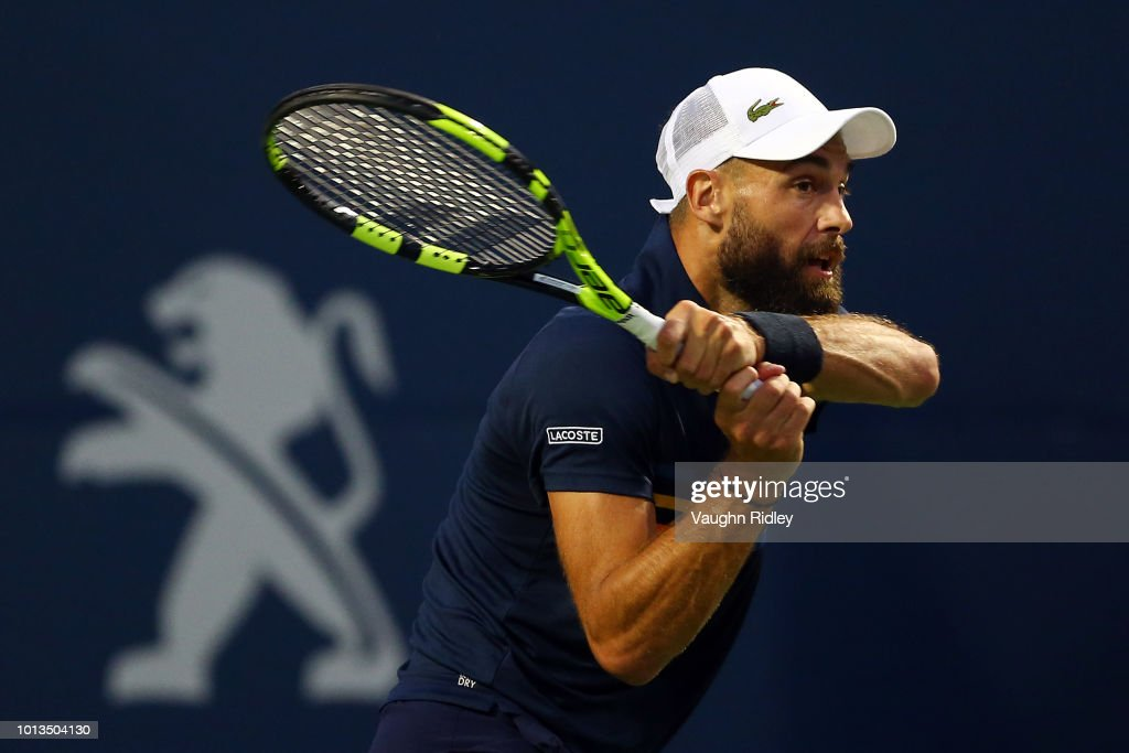 Benoit Paire of France plays a shot against Rafael Nadal of Spain during a 2nd round match on Day 3 of the Rogers Cup at Aviva Centre on August 8, 2018 in Toronto, Canada.