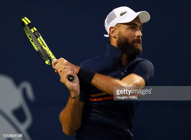 Benoit Paire of France plays a shot against Rafael Nadal of Spain during a 2nd round match on Day 3 of the Rogers Cup at Aviva Centre on August 8...