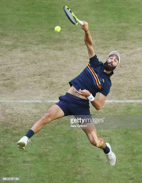 Benoit Paire of France plays a smash to Roger Federer of Switzerland during their round of 16 match on day 4 of the Gerry Weber Open at Gerry Weber...