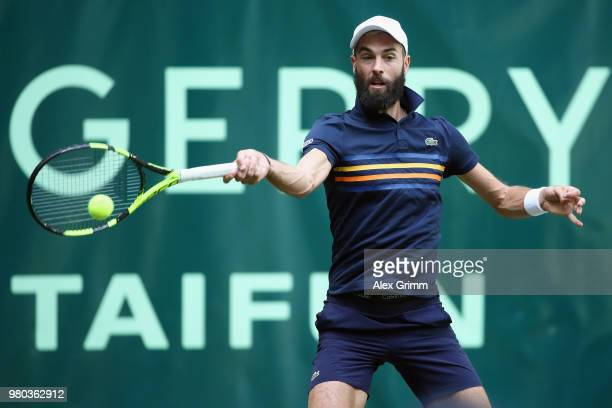 Benoit Paire of France plays forehand to Roger Federer of Switzerland during their round of 16 match on day 4 of the Gerry Weber Open at Gerry Weber...