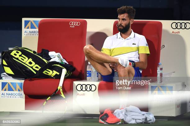 Benoit Paire of France prior to receiving medical treatment during his match against Roger Federer of Switzerland on day two of the ATP Dubai Duty...