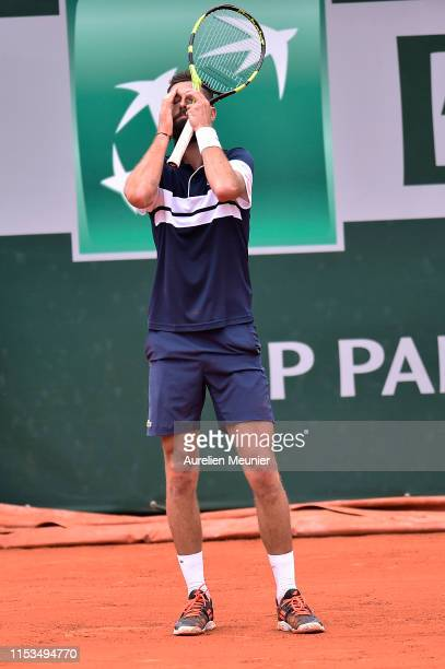 Benoit Paire of France reacts during his mens singles fourth round match against Kei Nishikori of Japan during day nine of the 2019 French Open at...