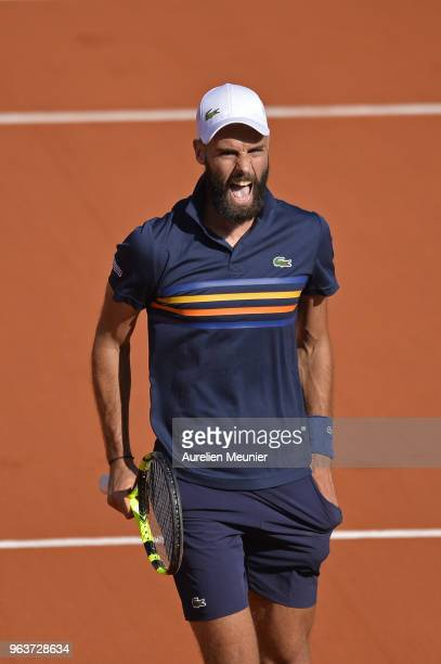 Benoit Paire of France reacts during his mens singles second round match against Kei Nishikori of Japan during day 4 of the 2018 French Open at...