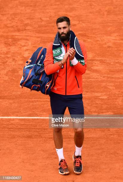 Benoit Paire of France reacts following defeat during his mens singles fourth round match against Kei Nishikori of Japan during Day nine of the 2019...