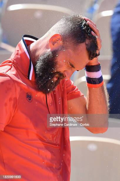 Benoit Paire of France reacts in their mens singles first round match against Casper Ruud of Norway on day two of the 2021 French Open at Roland...